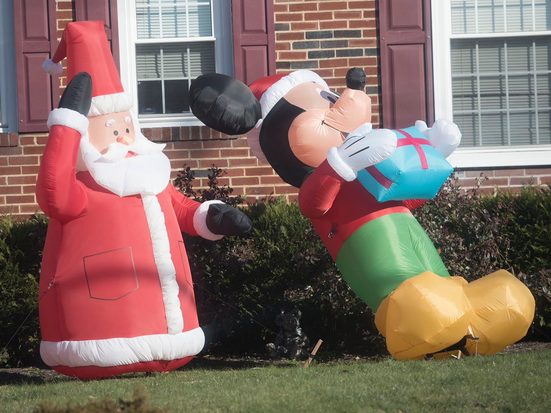 A whimsical inflated Santa and Mickey Mouse appear to greet passersby as part of a Christmas decoration along Wayne Avenue, Chambersburg. There are just about a dozen days left to shop for Christmas gifts.