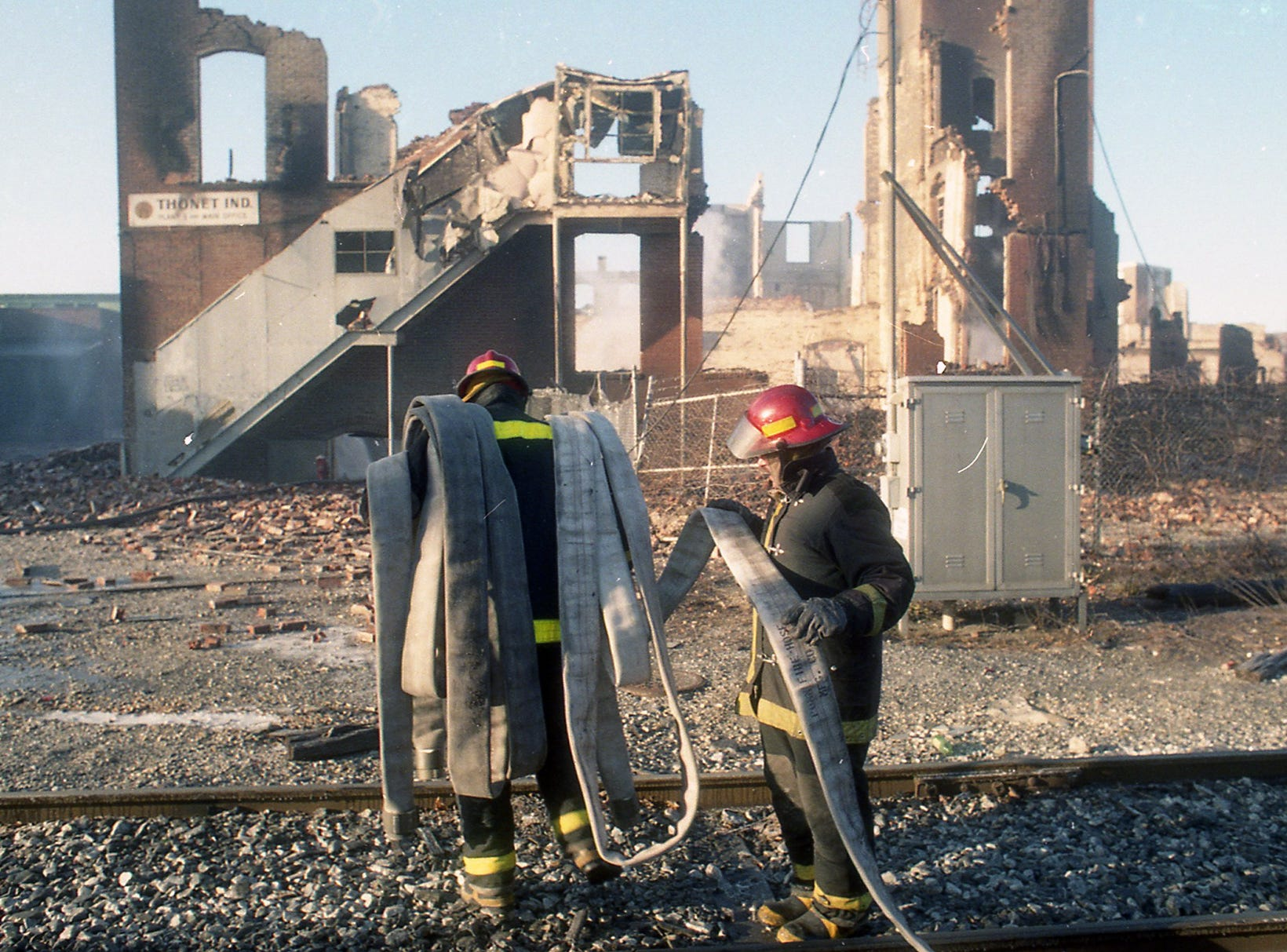 Firefighters collect hoses the morning after the Thonet fire. A fire began at the former Thonet Furniture plant at 491 East Princess Street in York on December 11, 1993. Eventually, the four alarm fire spread through the complex of buildings and several other properties.