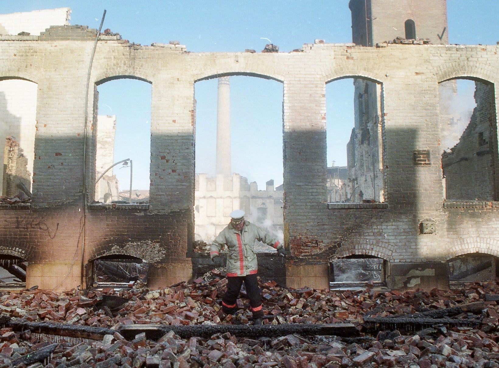 City of York Fire Department inspects the ruins of the Thonet complex the morning after the fire. A fire began at the former Thonet Furniture plant at 491 East Princess Street in York on December 11, 1993. Eventually, the four alarm fire spread through the complex of buildings and several other properties.