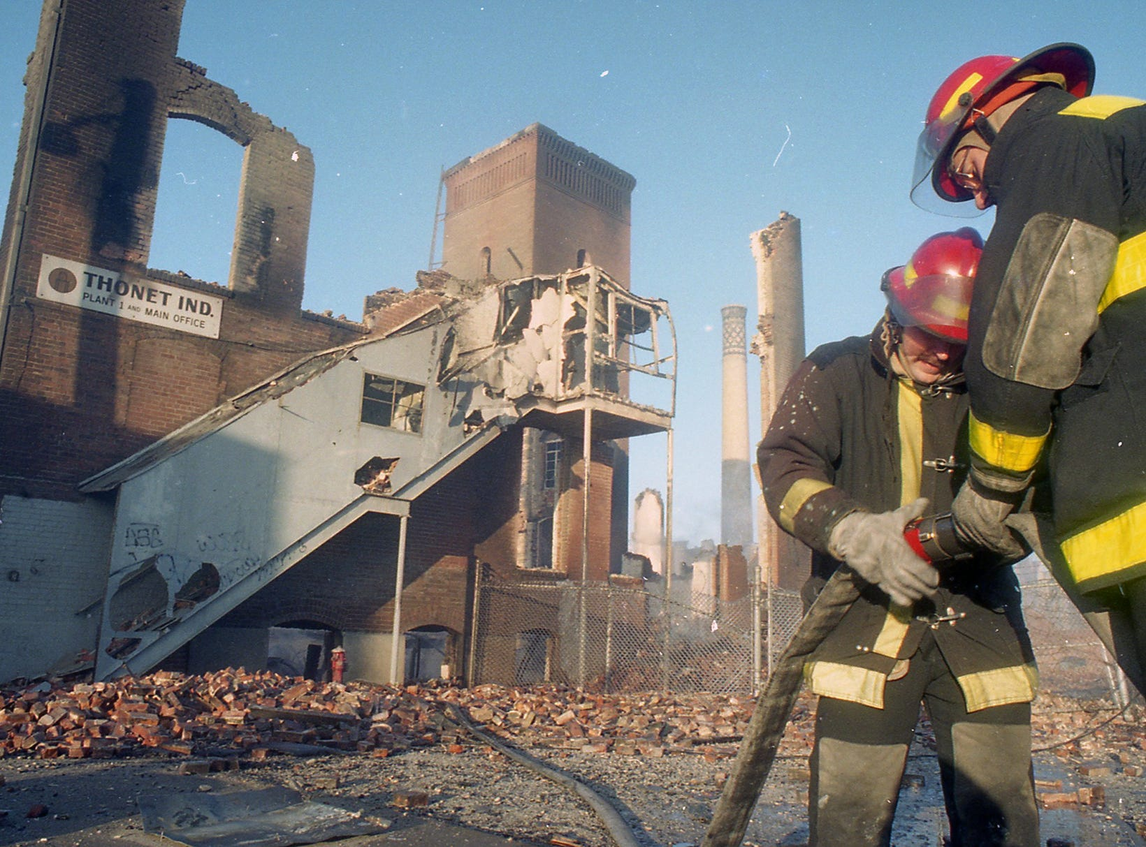 Firefighters disconnect hoses the morning after the fire. A fire began at the former Thonet Furniture plant at 491 East Princess Street on December 11, 1993. Eventually, the four alarm fire spread through the complex of buildings and several other properties.