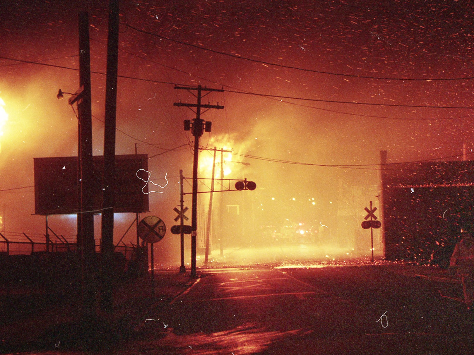 Sparks and flaming debris falls on buildings across East Princess Street. A fire began at the former Thonet Furniture plant at 491 East Princess Street on December 11, 1993. Eventually, the four alarm fire spread through the complex of buildings and several other properties.