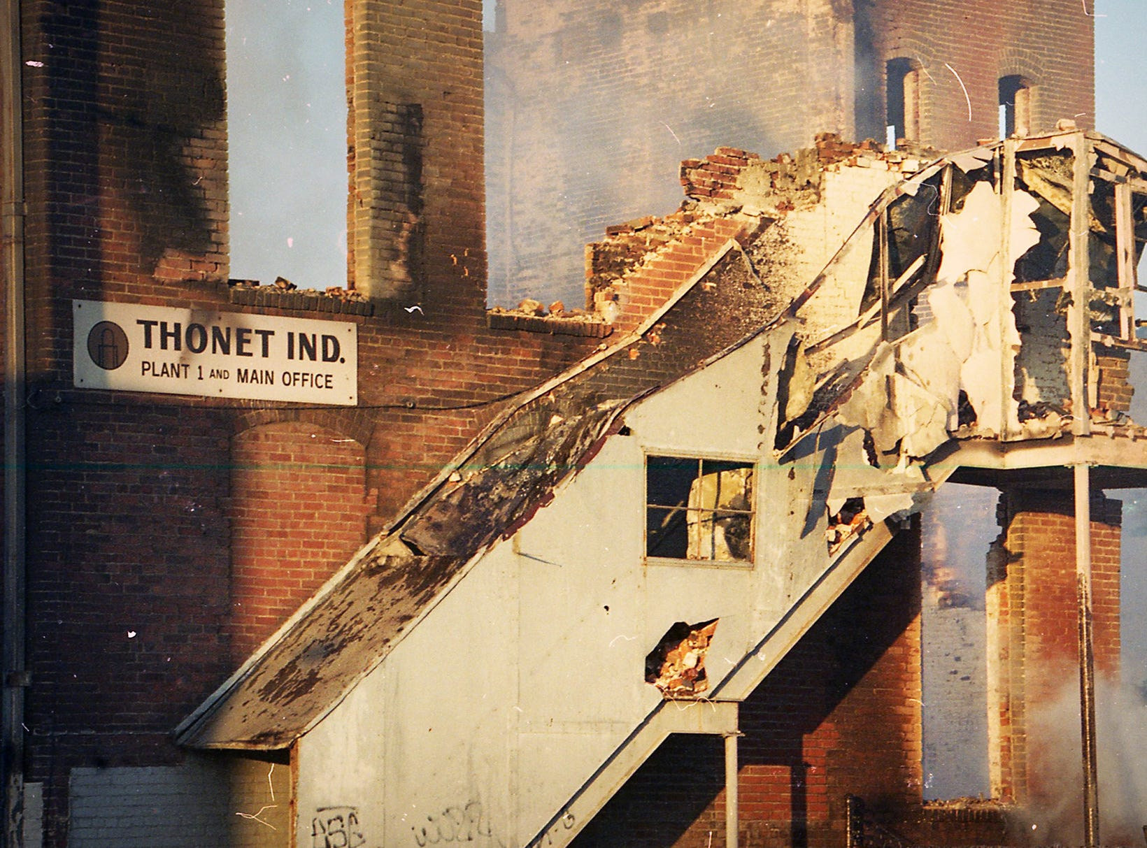 A burned out fire escape and a wall still stands the morning after the fire. A fire began at the former Thonet Furniture plant at 491 East Princess Street on December 11, 1993. Eventually, the four alarm fire spread through the complex of buildings and several other properties.