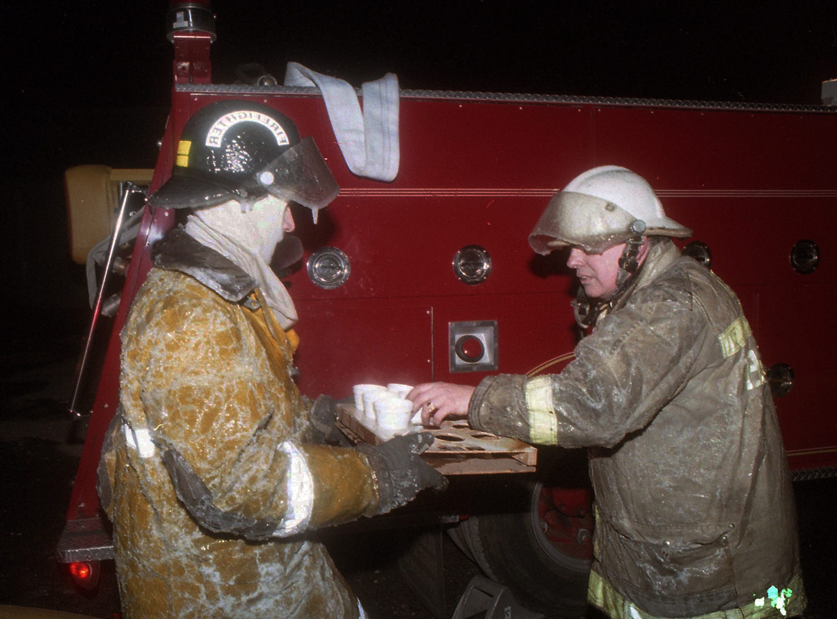 Firefighters take hot beverages during the fire. A fire began at the former Thonet Furniture plant at 491 East Princess Street in York on December 11, 1993. Eventually, the four alarm fire spread through the complex of buildings and several other properties.