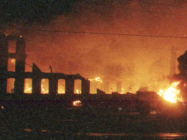 A wide shot shows the Thonet complex in advanced stages of the fire. A fire began at the former Thonet Furniture plant at 491 East Princess Street in York on December 11, 1993. Eventually, the four alarm fire spread through the complex of buildings and several other properties.