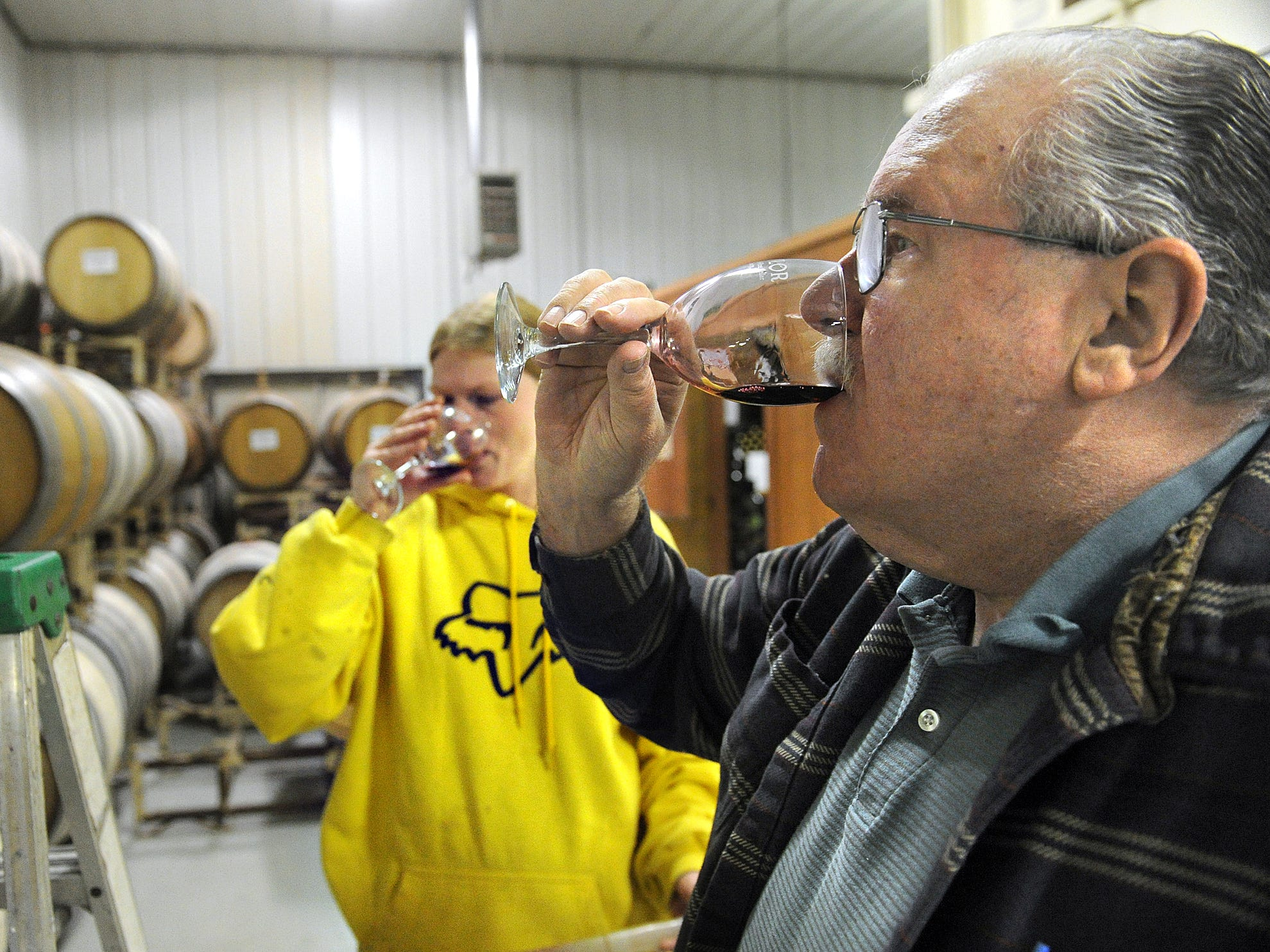 Wine maker Ted Potter and Angel Kellison, the lab technician with Naylor Wine Cellars, sample wine in the Stewartstown Thursday, Feb. 20, 2014.