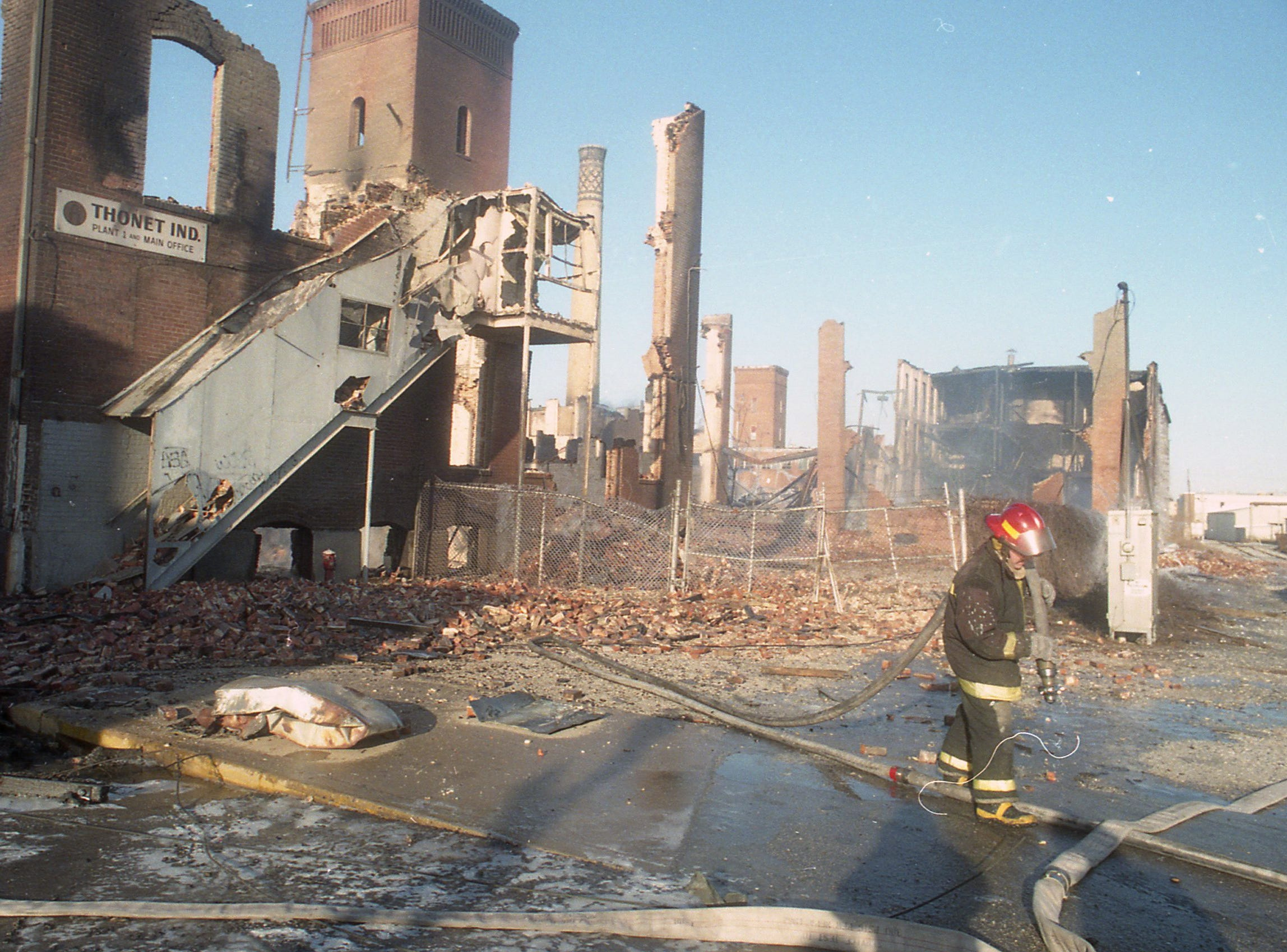Firefighters hit hot spots the morning after the fire. A fire began at the former Thonet Furniture plant at 491 East Princess Street in York on December 11, 1993. Eventually, the four alarm fire spread through the complex of buildings and several other properties.