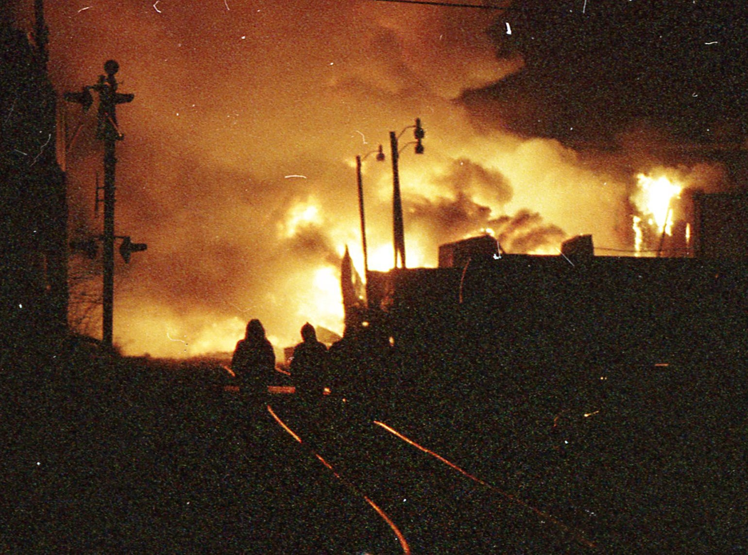 The fire reflects off railroad tracks. A fire began at the former Thonet Furniture plant at 491 East Princess Street on December 11, 1993. Eventually, the four alarm fire spread through the complex of buildings and several other properties.