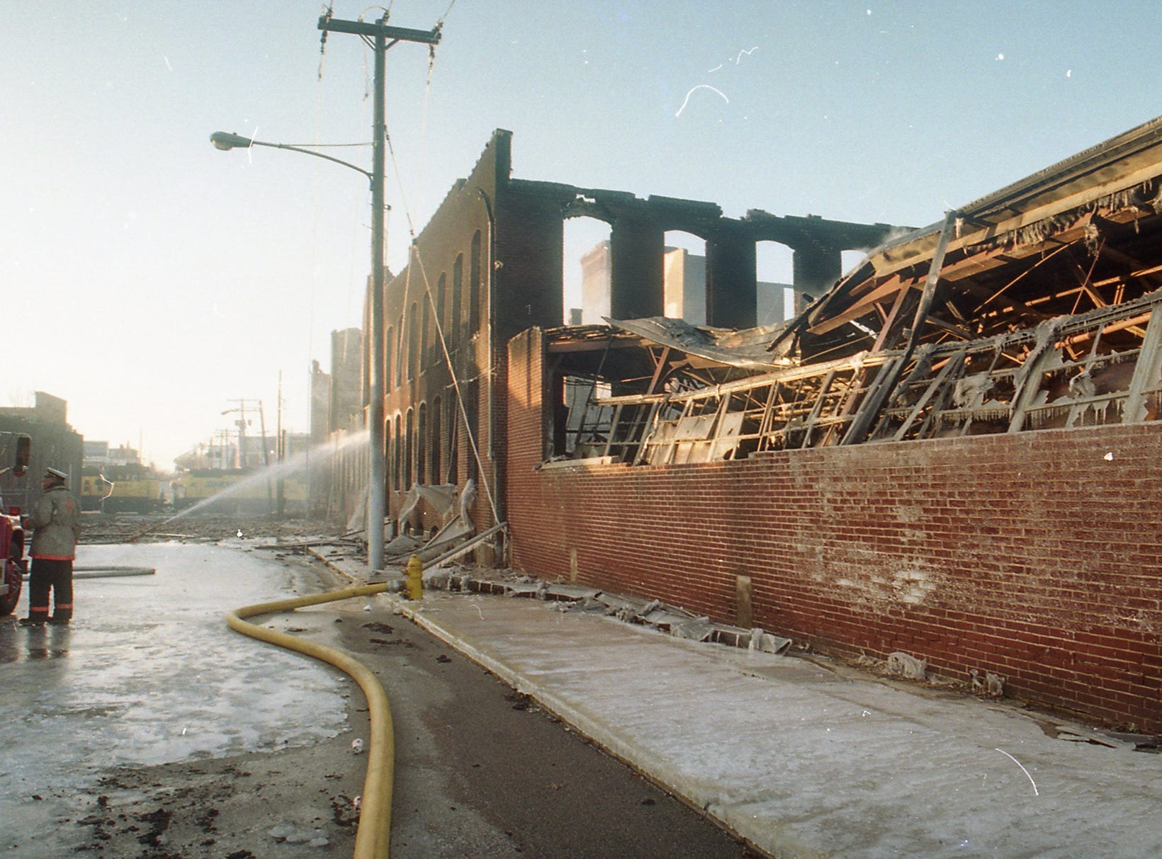 The ruins of the Thonet complex the morning after the fire. A fire began at the former Thonet Furniture plant at 491 East Princess Street on December 11, 1993. Eventually, the four alarm fire spread through the complex of buildings and several other properties.