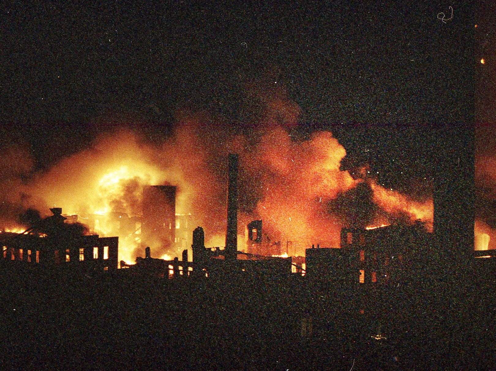 A wide shot shows the entire Thonet complex in advanced stages of the fire. A fire began at the former Thonet Furniture plant at 491 East Princess Street in York on December 11, 1993. Eventually, the four alarm fire spread through the complex of buildings and several other properties.
