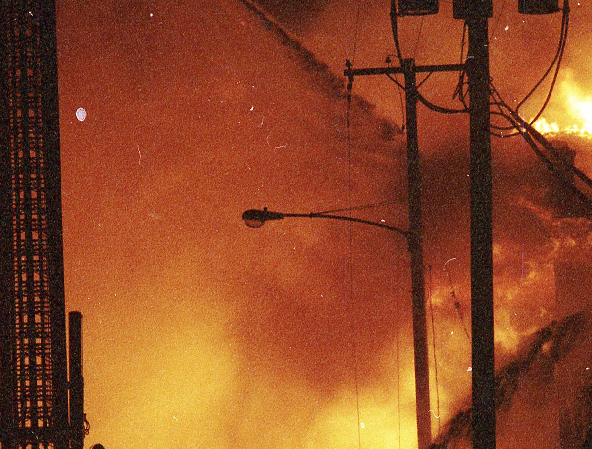 Firefighters shoot water from above and below the fire. A fire began at the former Thonet Furniture plant at 491 East Princess Street on December 11, 1993. Eventually, the four alarm fire spread through the complex of buildings and several other properties.