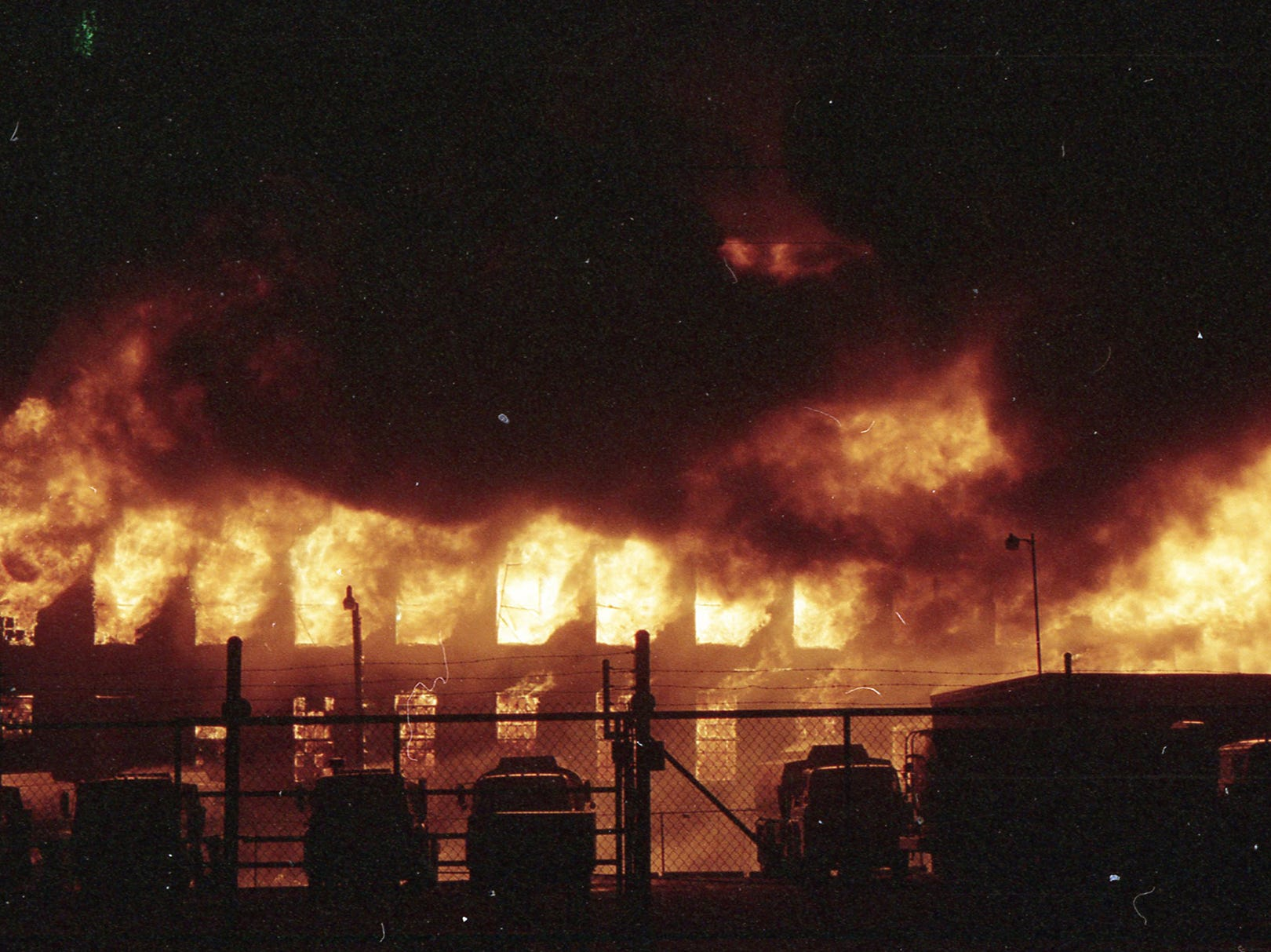 Fire rages from the upper floors of the former Thonet building before going through the roof. A fire began at the former Thonet Furniture plant at 491 East Princess Street on December 11, 1993. Eventually, the four alarm fire spread through the complex of buildings and several other properties.