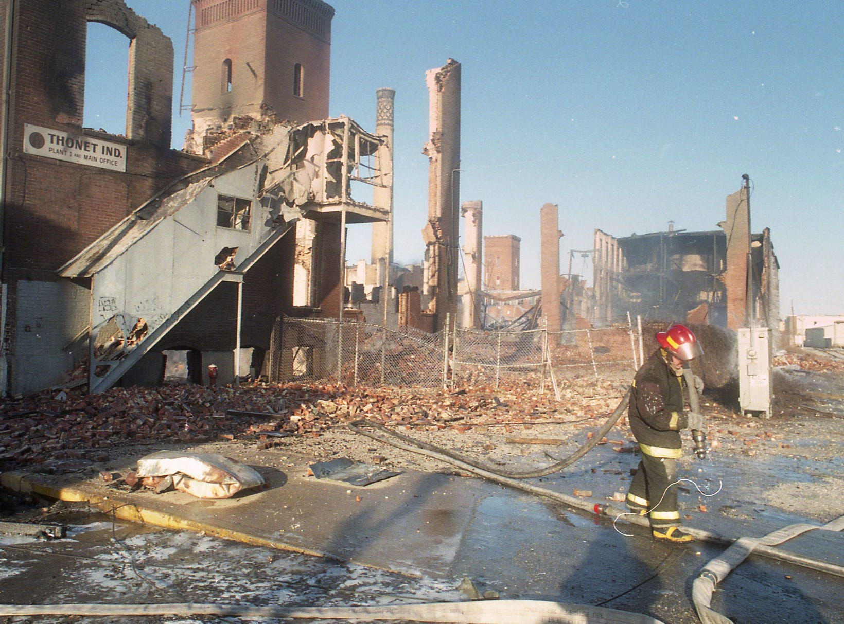 City of York Fire Department hoses down hot spots the morning after the fire. A fire began at the former Thonet Furniture plant at 491 East Princess Street in York on December 11, 1993. Eventually, the four alarm fire spread through the complex of buildings and several other properties.