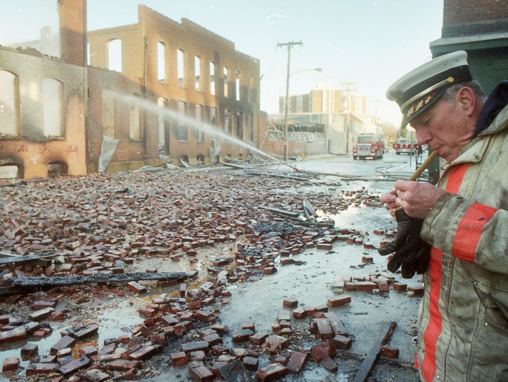 A York city fire official takes a cigar break the morning after the fire. A fire began at the former Thonet Furniture plant at 491 East Princess Street on December 11, 1993. Eventually, the four alarm fire spread through the complex of buildings and several other properties.