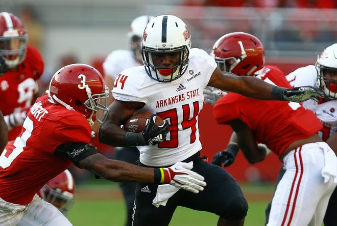 Arkansas State running back Marcel Murray (34) tries to get past the Alabama defense during the teams' game in September.