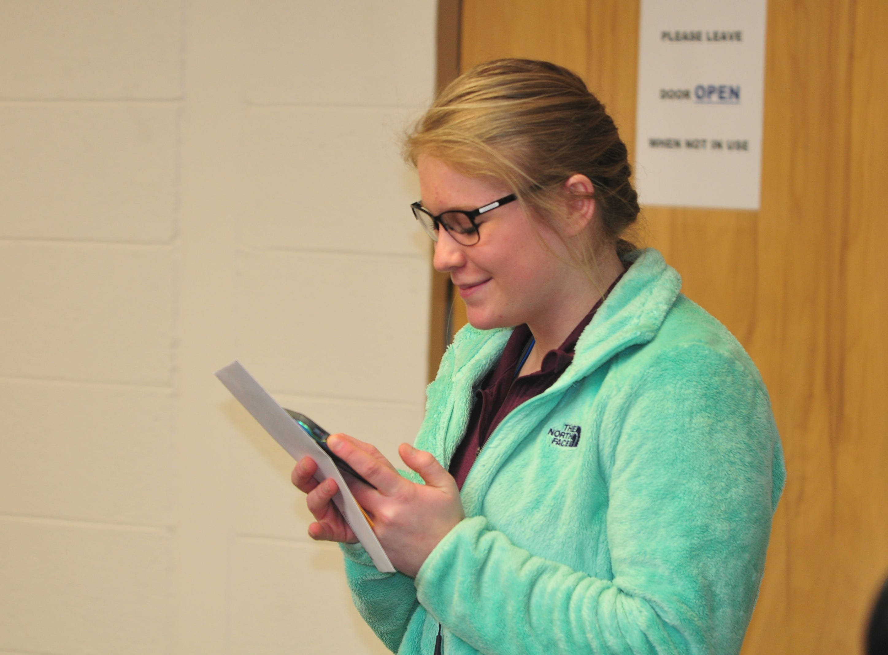 Centerville High School senior Molly Coomes calls her father after learning that she is a recipient of the Wayne County Foundation's Lily Endowment Community Scholarship at Centerville High School Tuesday, Dec. 11, 2018.