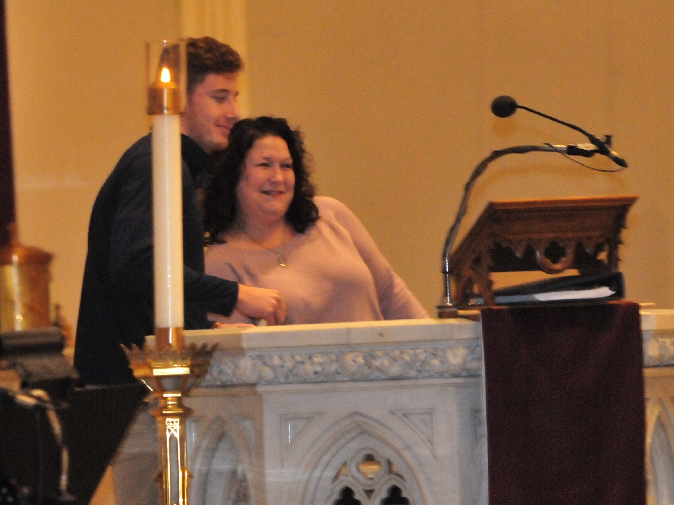 Seton Catholic senior Joseph Lahmann, left, hugs Wayne County Foundation Program Officer Lisa Bates after finding out he won the Lilly Endowment Community Scholarship after morning mass at St. Andrew's Catholic Church in Richmond Tuesday, Dec. 11, 2018.