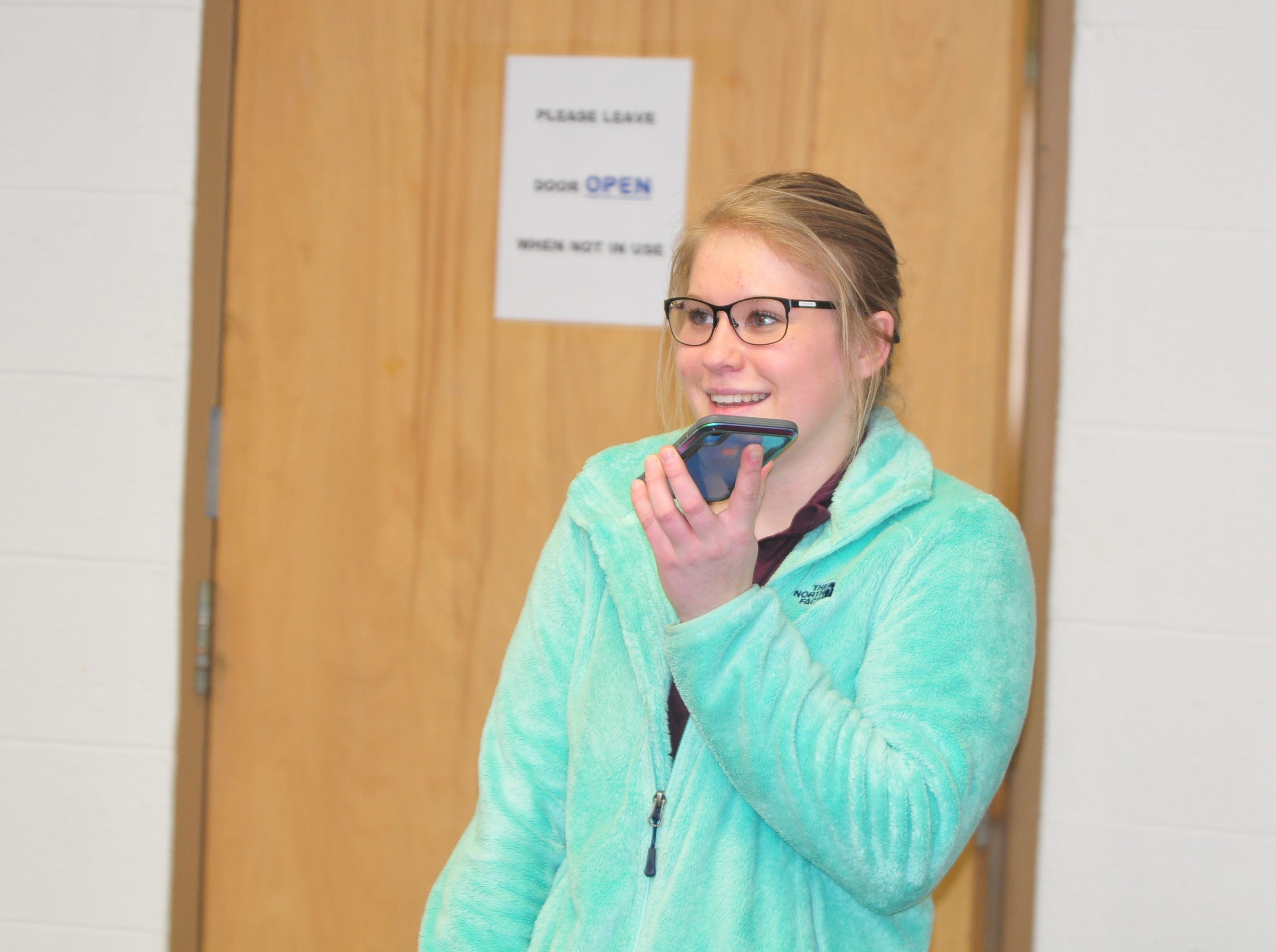 Centerville High School senior Molly Coomes talks on the phone with her father after learning that she is a recipient of the Wayne County Foundation's Lily Endowment Community Scholarship at Centerville High School Tuesday, Dec. 11, 2018.