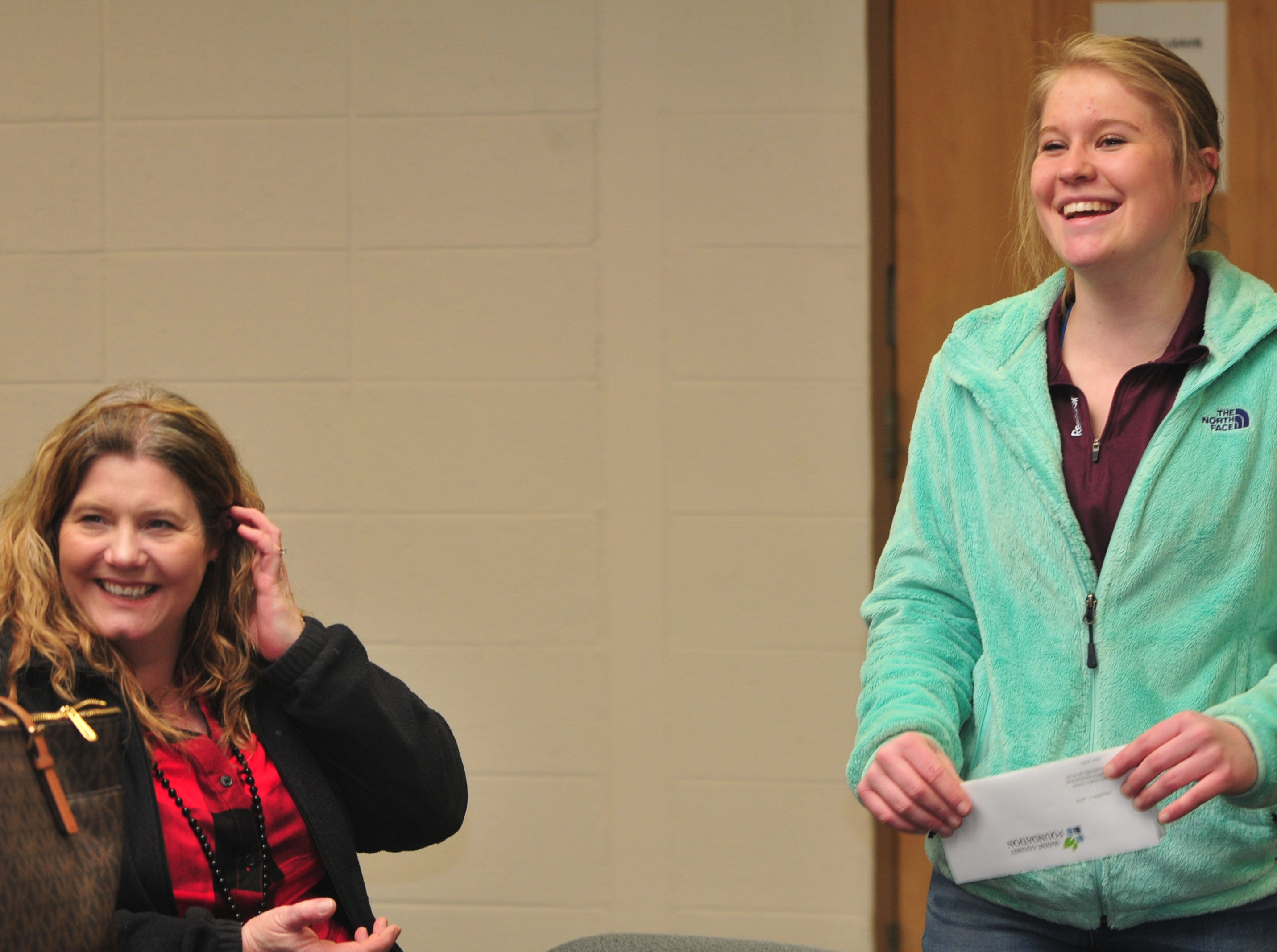 Centerville High School senior Molly Coomes, right, with mother Renee Westover after learning that Coomes is a recipient of the Wayne County Foundation's Lily Endowment Community Scholarship at Centerville High School Tuesday, Dec. 11, 2018.