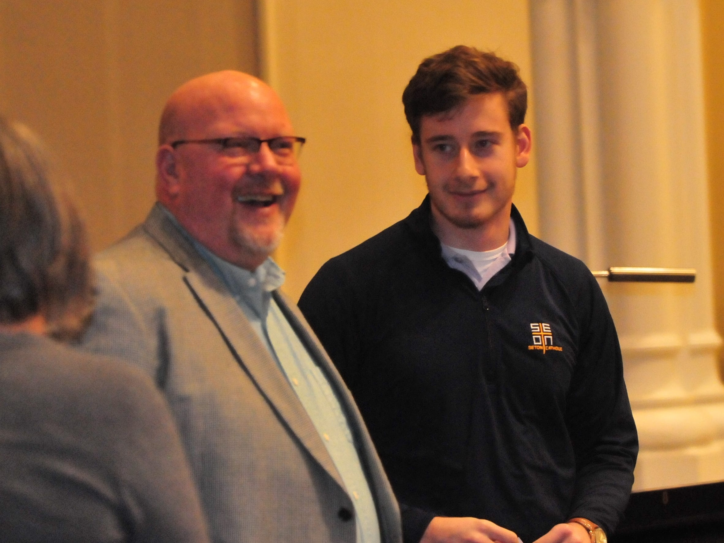 Seton Catholic senior Joseph Lahmann, right, with his father Patrick after finding out he won the Lilly Endowment Community Scholarship after morning mass at St. Andrew's Catholic Church in Richmond Tuesday, Dec. 11, 2018.