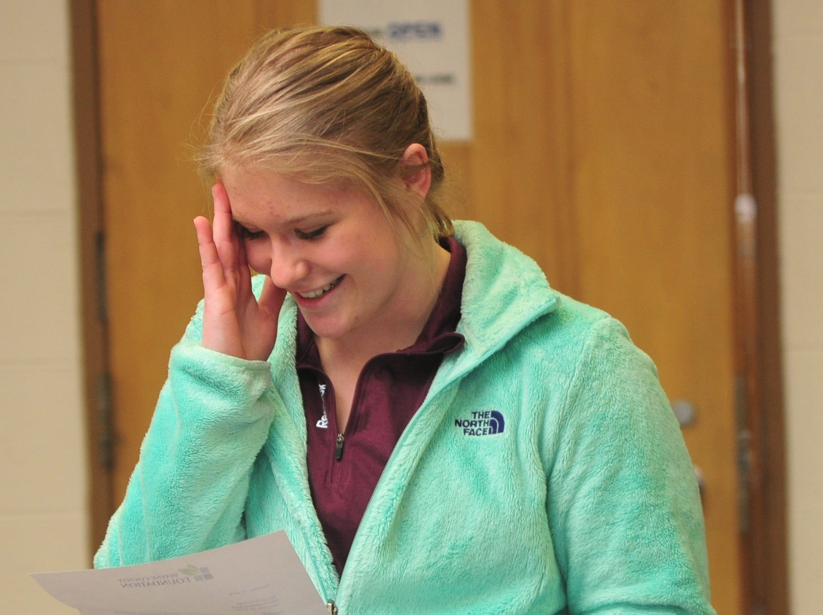 Centerville High School senior Molly Coomes reacts while reading her letter notifying her that she is a recipient of the Wayne County Foundation's Lily Endowment Community Scholarship at Centerville High School Tuesday, Dec. 11, 2018.