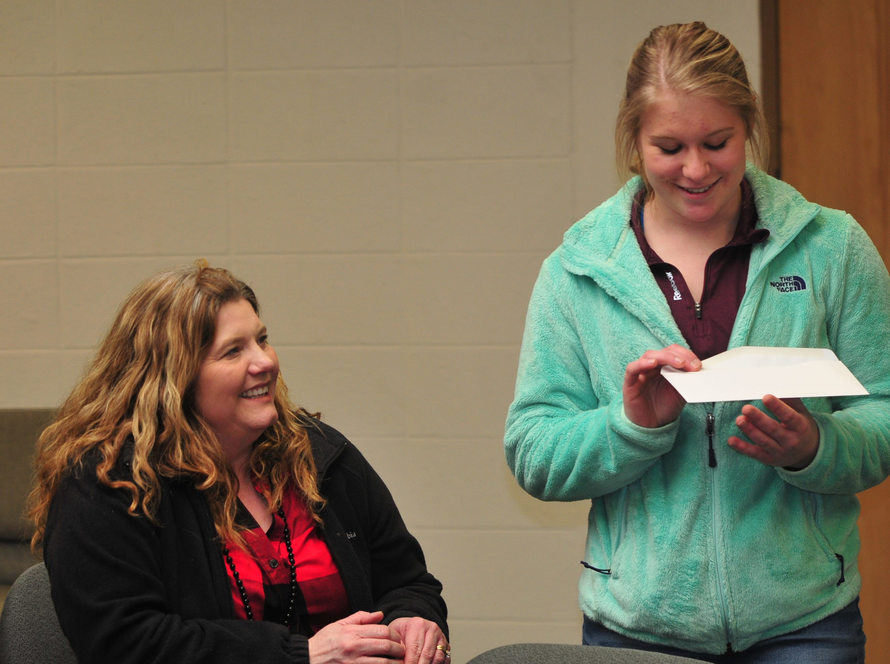 Centerville High School senior Molly Coomes, right, with mother Renee Westover, after Coomes learned that she is a recipient of the Wayne County Foundation's Lily Endowment Community Scholarship at Centerville High School Tuesday, Dec. 11, 2018.