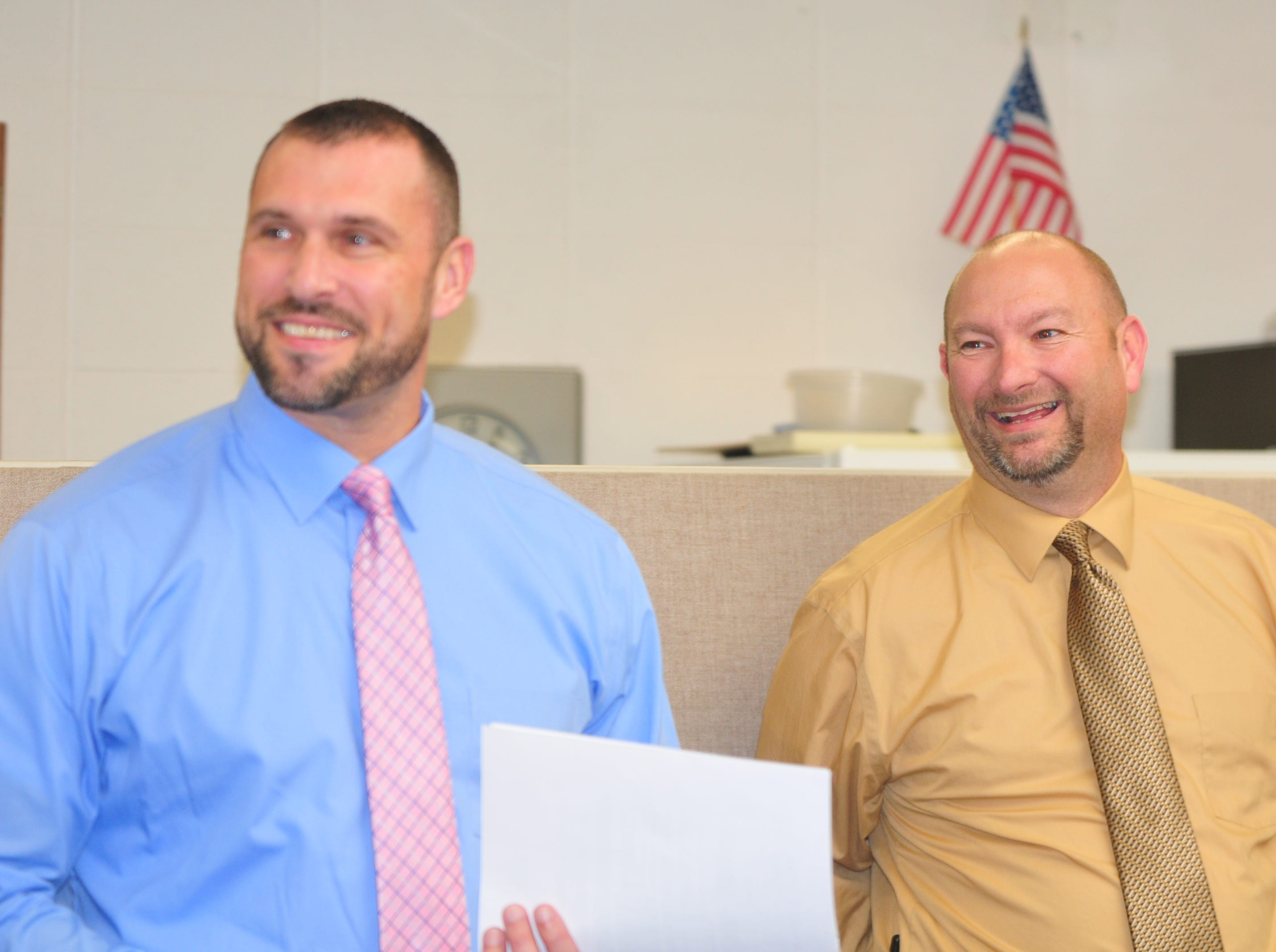 Centerville High School principal Mike McCoy, right, and assistant principal Tim Hollendonner react after notifying senior Molly Coomes that she is a recipient of the Wayne County Foundation's Lily Endowment Community Scholarship at Centerville High School Tuesday, Dec. 11, 2018.
