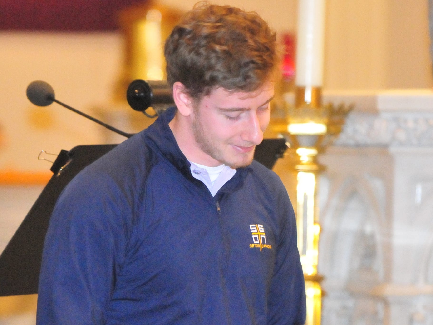 Seton Catholic senior Joseph Lahmann after finding out he won the Lilly Endowment Community Scholarship after morning mass at St. Andrew's Catholic Church in Richmond Tuesday, Dec. 11, 2018.