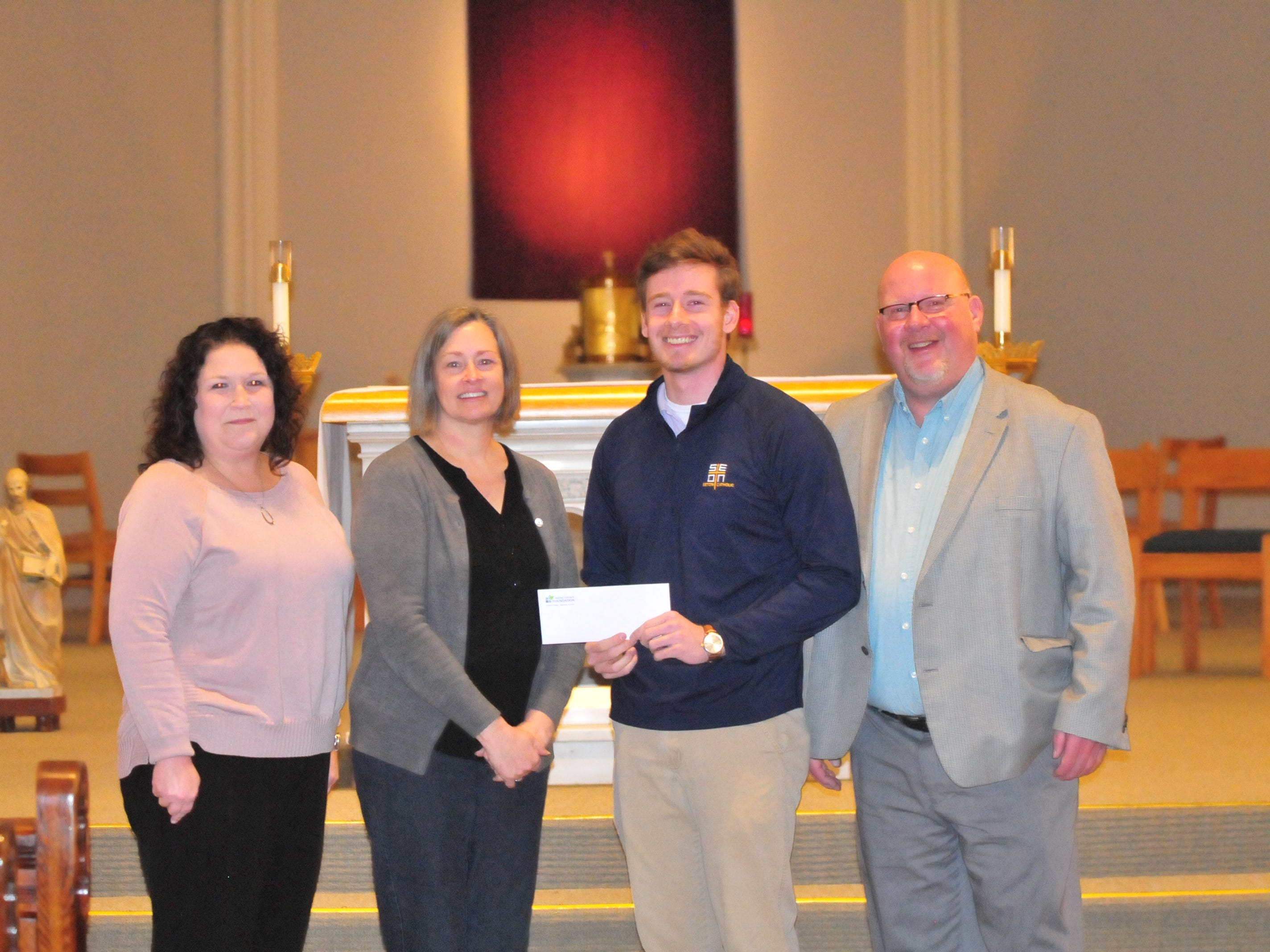 Seton Catholic senior Joseph Lahmann, third from left, with Wayne County Foundation Program Officer Lisa Bates, mother Margaret Rees Lahman, and father Patrick Lahmann, after finding out Joseph won the Lilly Endowment Community Scholarship after morning mass at St. Andrew's Catholic Church in Richmond Tuesday, Dec. 11, 2018.