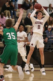 Aquinas' Jack Bleier puts up a three-pointer over Bishop Ludden's Patrick Anson.