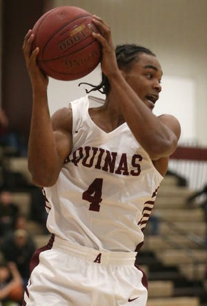 Aquinas forward James Jones pulls down a rebound during Monday's loss to Bishop Ludden.