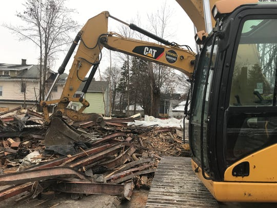 Demolition equipment and rubble are all that remain after a 5-alarm fire at a Thurston Rd apartment building