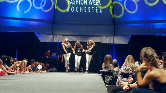 Shari Hall Smith rocks the Fashion Week of Rochester stage with her daughters.