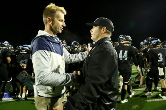 Central Valley Christian head coach Mason Hughes congratulates Pleasant Valley head coach Mark Cooley, (right) after the Viking won the Division 4-AA state championship game on Saturday night.   Cooley is the first Northern Section football coach to win two state championships.