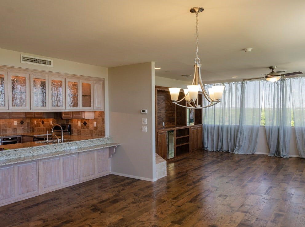 The living room of 800-7W  W Ave. D offers a view of the kitchen.