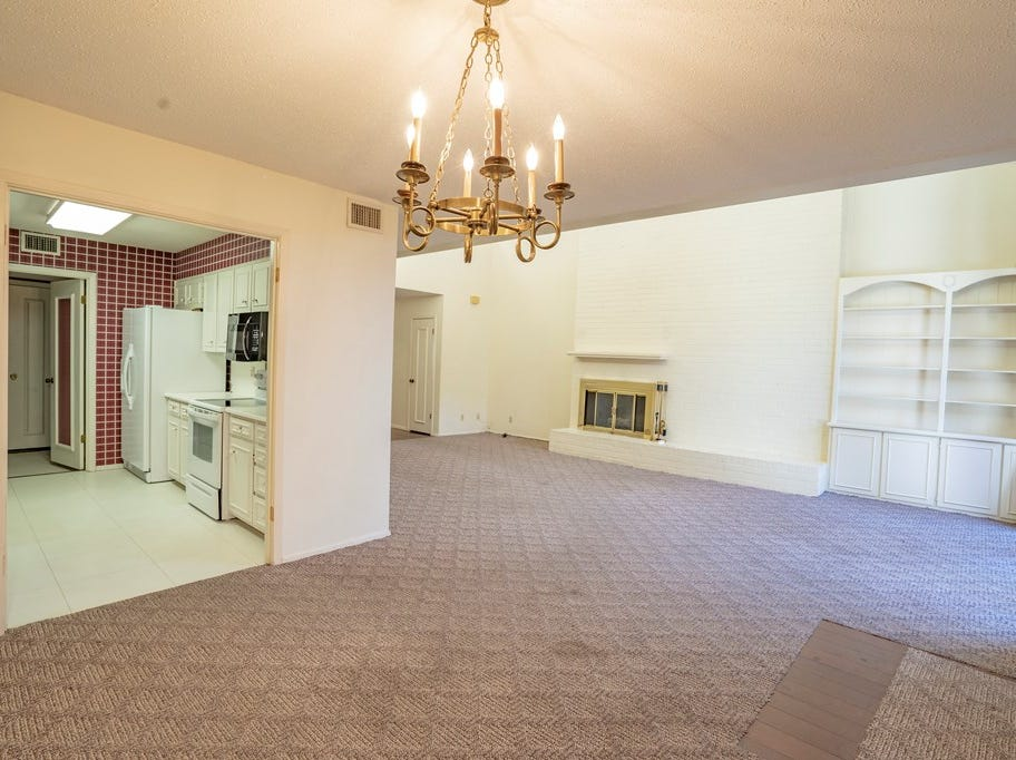 The interior of 2559 Lindenwood Drive shows off a red kitchen and some of the 2,400 square footage.