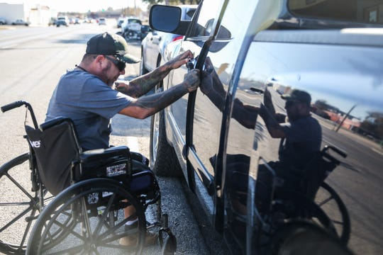 Jeremy Armenta opens the door to his truck Friday, Nov. 30, 2018, in San Angelo. Armenta's leg was severed in a boating accident July 4, 2018.