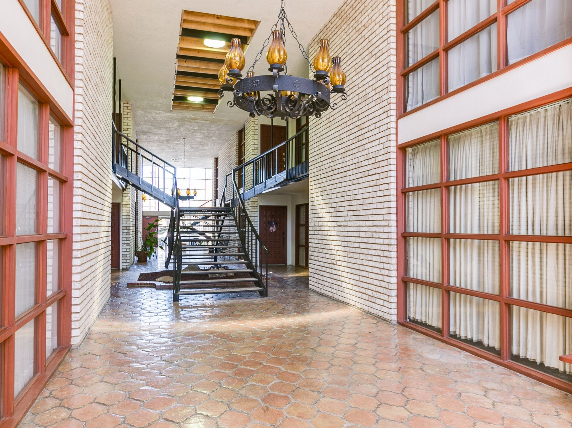 The interior hallway of the condos at 220 Twohig Ave. reveales a spacious and grand entrance.