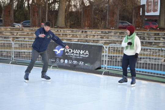 Salisbury Assistant City Administrator Andy Kitzrow and City Administrator Julia Glanz ice skate on the new city rink at the Pohanka Riverwalk Amphitheater on Monday, Dec. 10, 2018.