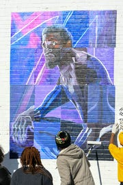 The Envision art club of University of Maryland Eastern Shore assembles a mural of Black Panther's T'Challa that they created in Princess Anne on Tuesday, Dec 11, 2018.