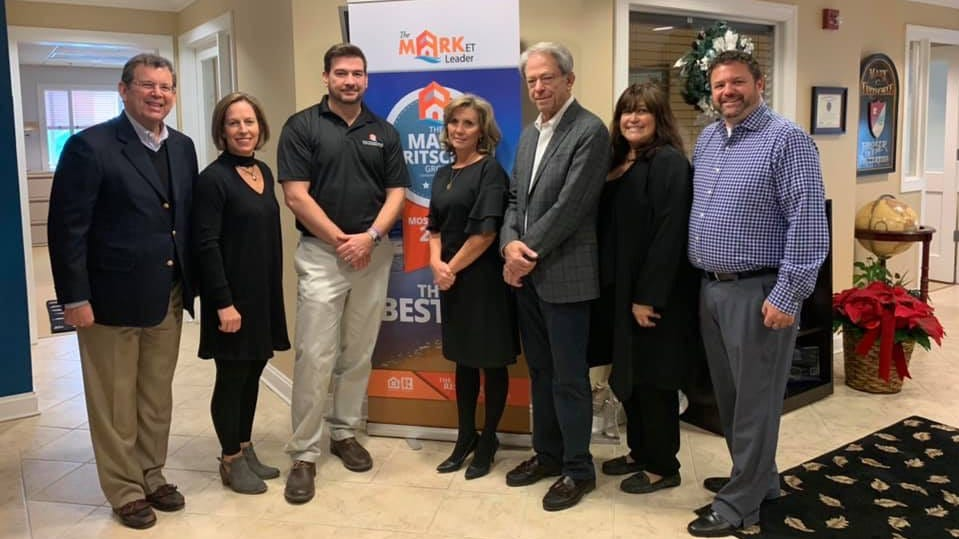 Michael Beer, Brigit Taylor, Grant Fritschle, Lora Fritschle, Gary Segal, Kelley Bjorkland and Matt Fetick after the Mark Fritschle Group and Keller Williams announced a merger of the two companies.