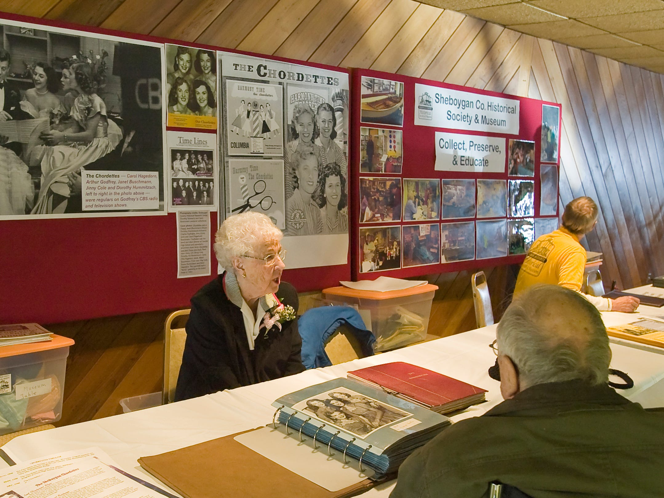 Dorothy Schwartz of the Chordettes speaks to a visitor to the booth about the famed group, Monday, May 2, 2011, at the Sheboygan County Local History Expo 2011 at Range Line Inn in Kohler, Wis.