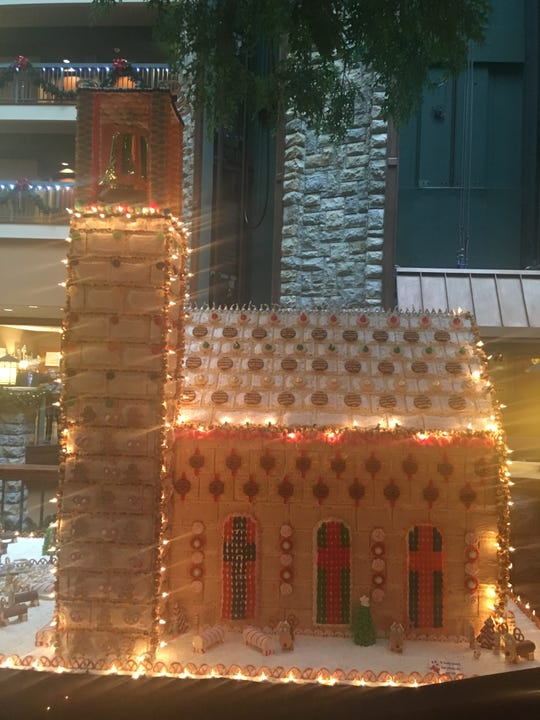 It took 300 pounds of powdered sugar, 120 pounds of eggs and 600 pounds of candy, cookies, pretzels and crackers to construct all the buildings in the gingerbread land at Chateau on the Lake.