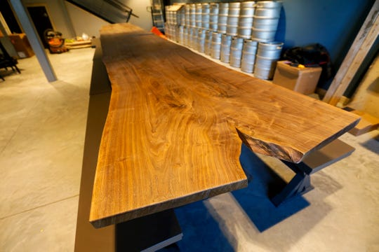 The beer hall style table on the first floor at Great Escape Beer Works is made of Missouri black walnut.