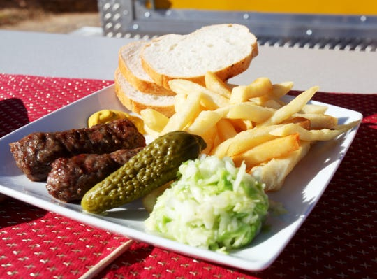 Dacia is a food truck that opened in August offering Romanian food like these mici, or ground mutton-and-pork rolls.
