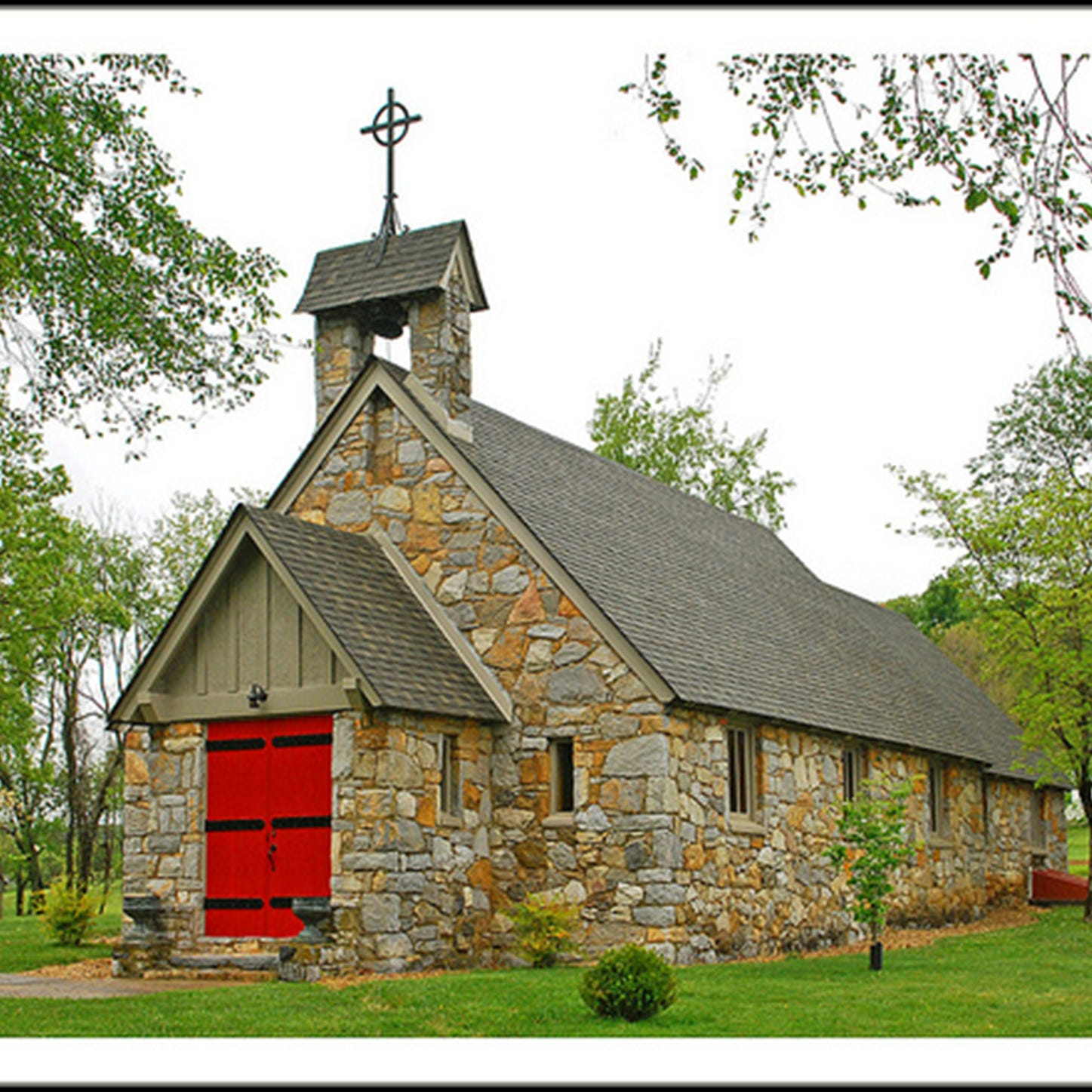 Stone church with red doors has fascinating history