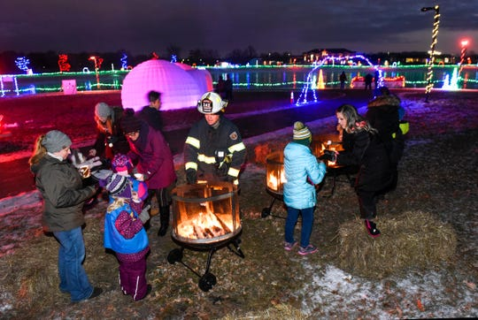Sartell firefighters host S'more Night at the Country Lights Festival Friday, Dec. 7, at the Lake Francis Park behind the Sartell Community Center.
