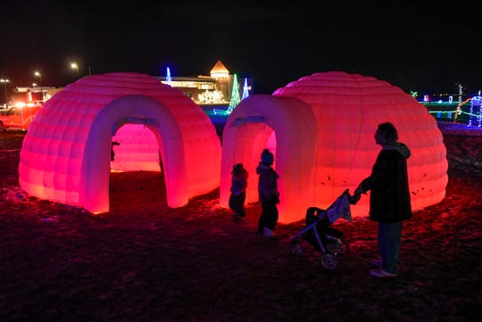 Children explore the inflated igloos at the Country Lights Festival Friday, Dec. 7, at the Lake Francis Park in Sartell.