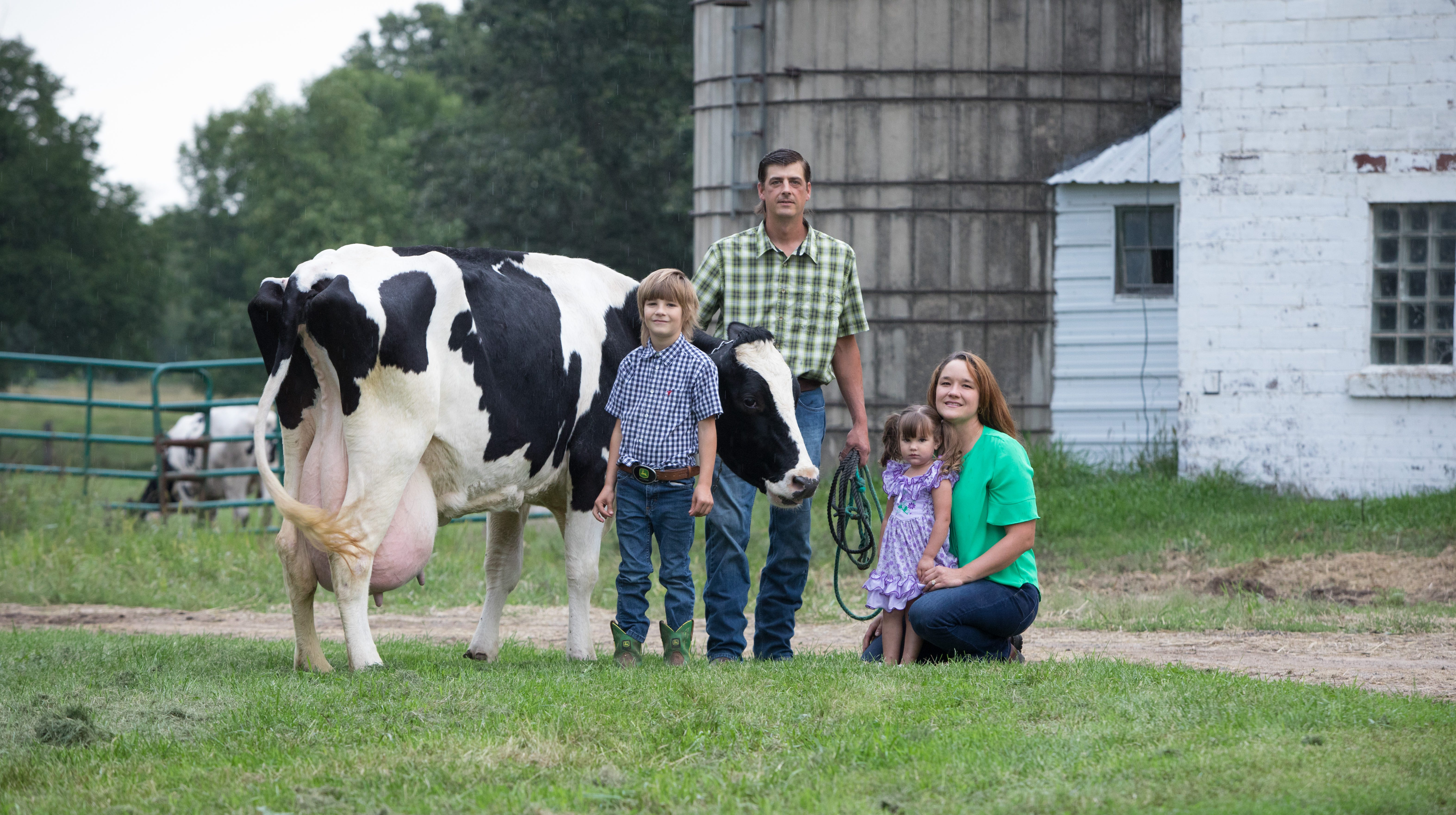 Brenda and Nathan Rudolph with their children Everett , 9, and Vivian, 4, on their Morrison County dairy farm.