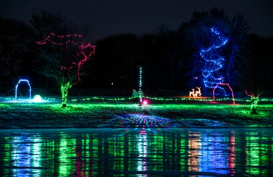 Lights reflect off the ice of the lighted trail around Lake Francis Park Friday, Dec. 7, during the Country Lights Festival in Sartell.