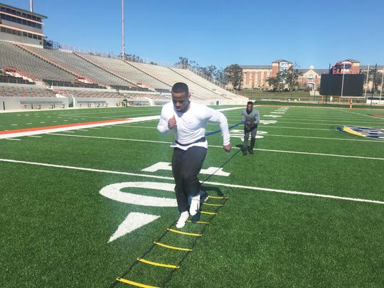 Former FAMU star Akil Blount runs through drills at Bragg Memorial Stadium. Blount is prepping for the upcoming season with the Orlando Apollos of the Alliance of American Football.